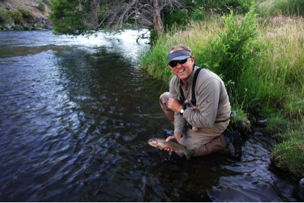 Chuck Kenlan with an early evening fish that rose to a caddis imitation. Photo by Greg McMillan.