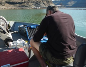 Rick Hafele doing water quality measurements on Lake Billy Chinook.