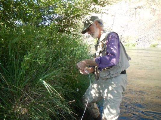 Larry Marxer installing a Hobo temp water temperature monitor. Photo by Greg McMillan.