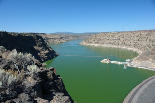 Round Butte Dam to the right, SWW Tower in center. View is looking west at Metolius Arm of Lake Billy Chinook.